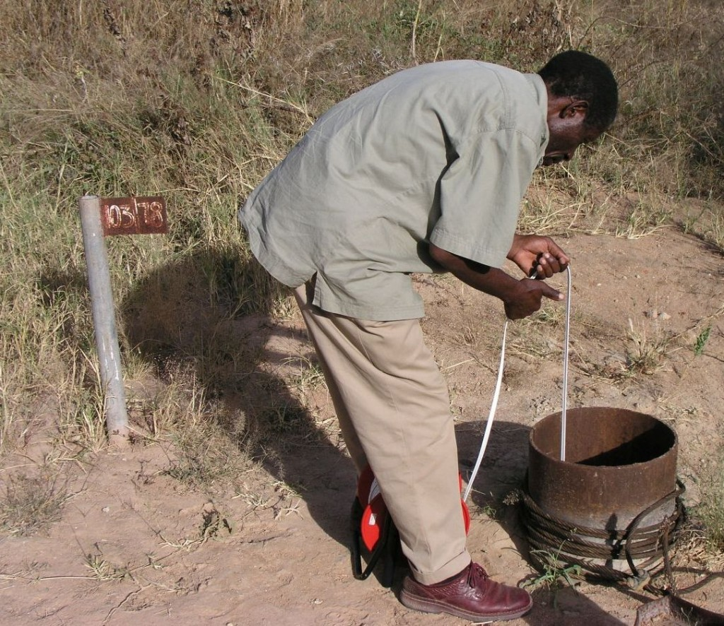 Stephen Katanga (WamiRuvu Basin Water Office) checking groundwater levels in the Makutapora